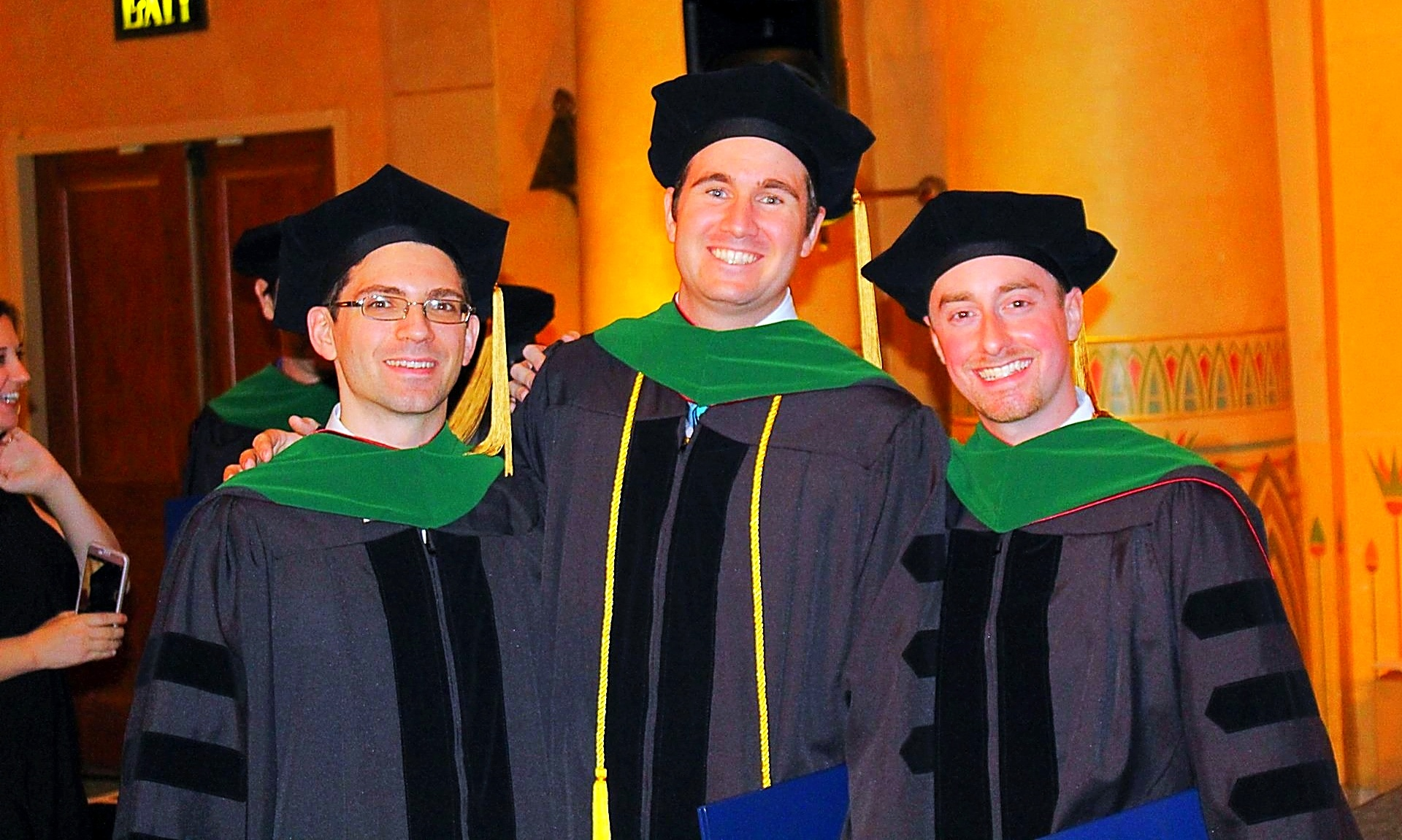 Trinity School of Medicine graduates celebrating their new, official status as physicians