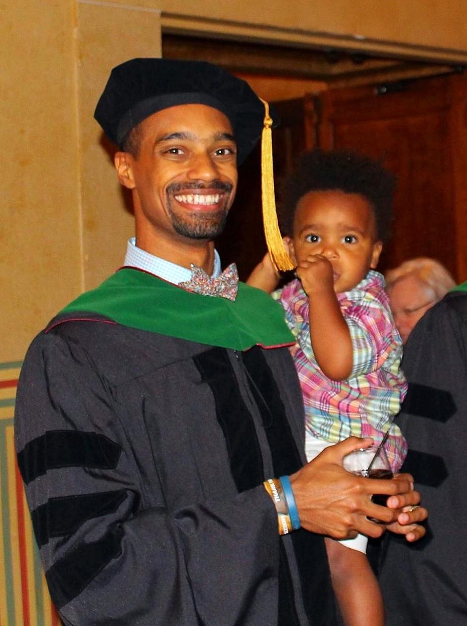 Trinity grad Dr. Leighton Elliot celebrates with family