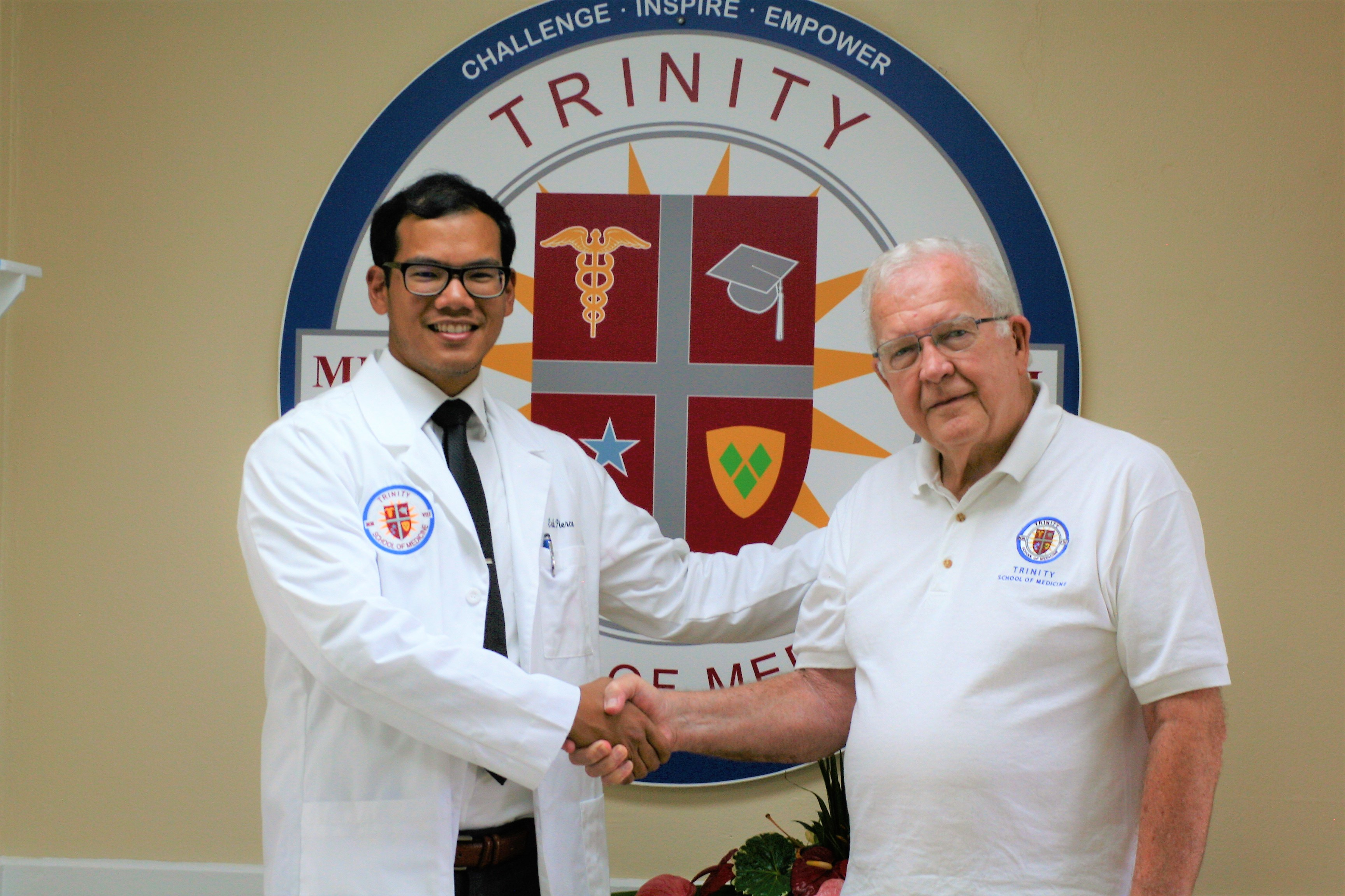 Trinity School of Medicine chancellor Doug Skelton, MD with scholarship recipient Eric Pierce