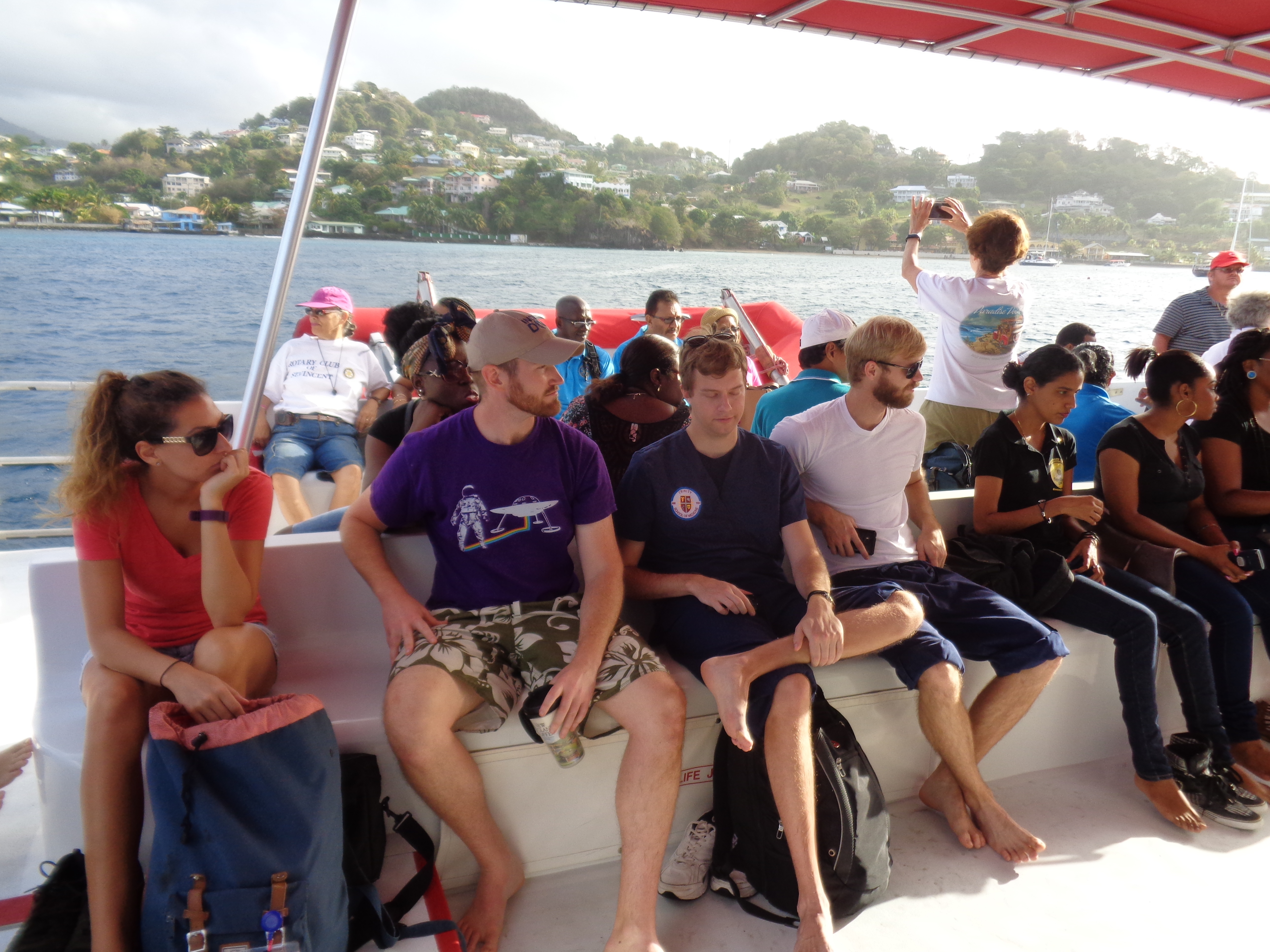 Students_and_other_volunteers_on_board_vessel_taking_them_to_Mayreau.jpg