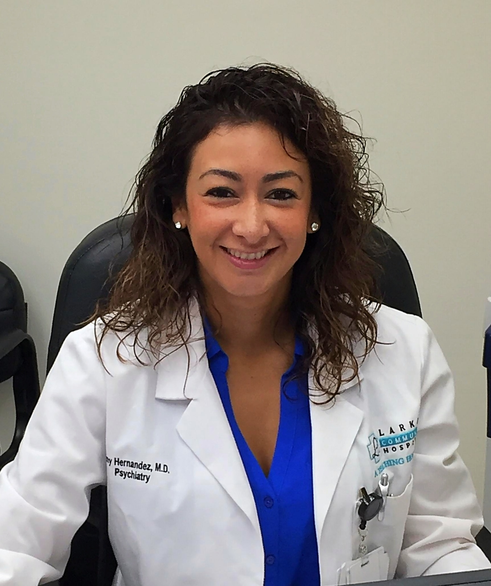 Trinity graduate Dr. Amy Hernandez in her office